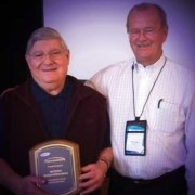 Allan presents Ray Ventura, Ventura Uniform Service, a special award for exceptional service to the textile industry